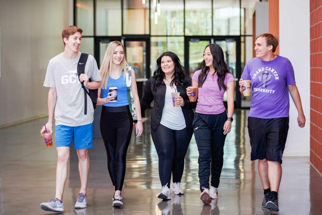GCU Students walking with GCBC drinks